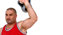 Determined man lifting heavy kettlebell Live Action