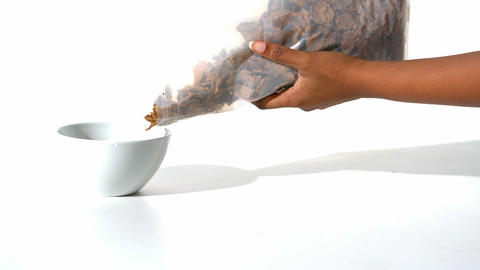 Woman pouring cereals in a bowl Footage