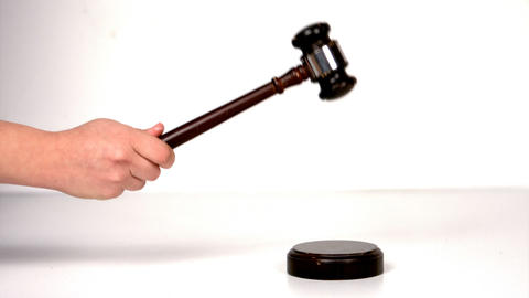 Close up of hand banging a law hammer on the gavel Live Action