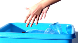 Feminine hands throwing bottles in the bin Footage