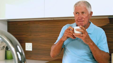 Senior man drinking coffee Footage