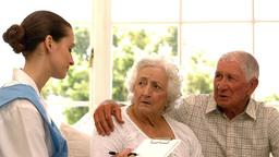 Senior couple talking to nurse Footage