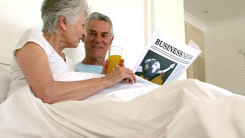 Senior couple reading newspaper Footage