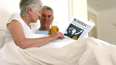 Senior couple reading newspaper Footage
