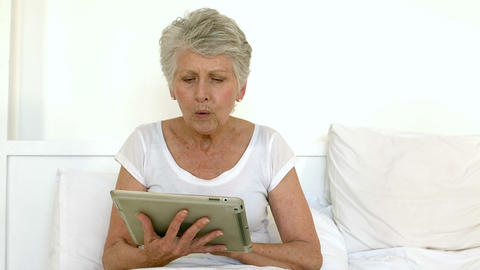Senior woman using tablet Footage