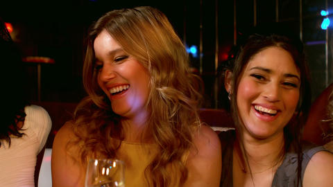 Cute friends having a glass of champagne Footage