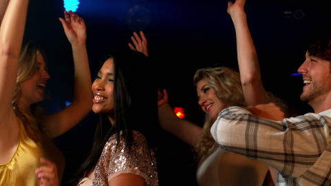 Happy friends dancing in the night club Stock Video Footage