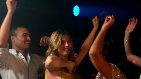 Happy friends dancing in the night club Footage