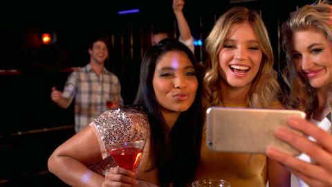 happy friends taking selfie at the night club Footage