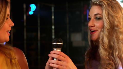 Happy friends singing at the karaoke in night club Footage