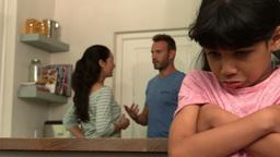Sad girl listening her parents arguing Footage