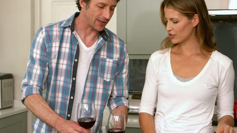 Cute couple having a glass of red wine Footage