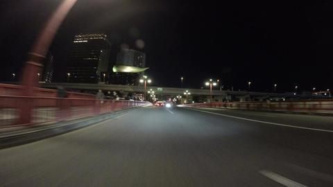 Nightscape drive over the Azumabashi Bridge over Sumida River and Asahi headquar Footage