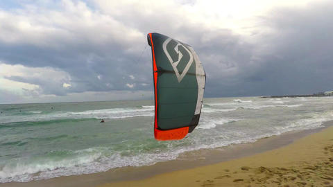 Windsurfer Trying To Get Up And Surf Image
