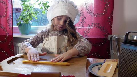 Girl baking a saffron bun Footage