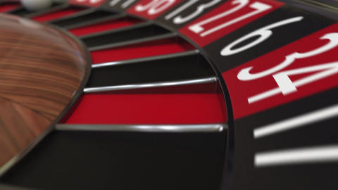 Casino roulette wheel ball hits 8 eight black Live Action