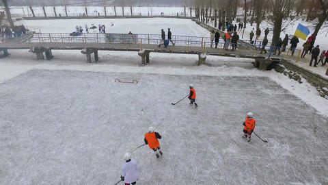 aerial view of the city winter park. men playing hockey on a frozen lake in a GIF