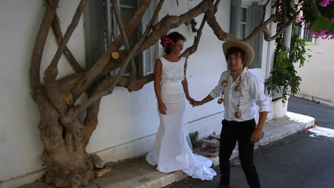 Wedding day in Greece. Beautiful newlyweds GIF