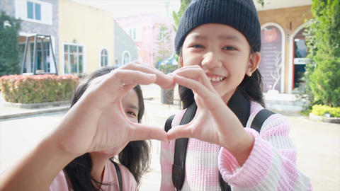 4K Asian little girl and mother showing hand make heart shape with happiness Footage