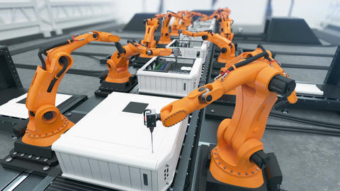 Robotic Arms Assembling Computers On Conveyor Belt Close-up. Advanced Automated Animation