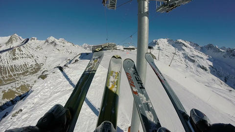 POV of skier riding and getting off chairlift Footage