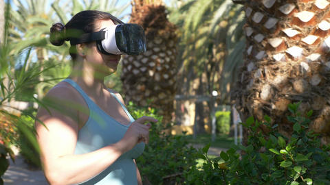 Video of woman exploring virtual reality in tropical resort in 4k ビデオ