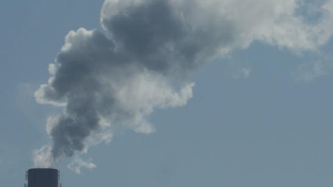Air pollution by smoke coming out of the factory chimneys Footage
