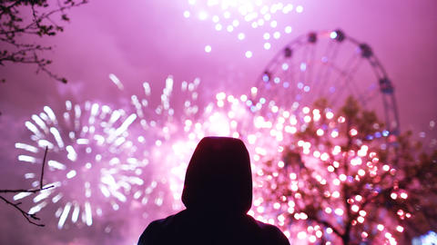 Closeup silhouette of alone man watching fireworks on new year celebration Photo