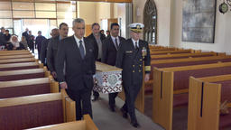shot of casket carry in or out of chapel during a funeral service Image