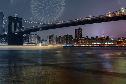 amazing sparkling fireworks Brooklyn Bridge at dusk viewed from New York City Photo
