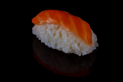salmon sushi served on the black dish Photo