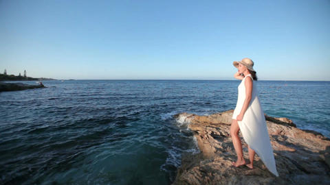 beautiful girl admires the sea. The concept of an excellent holiday in Greece Footage