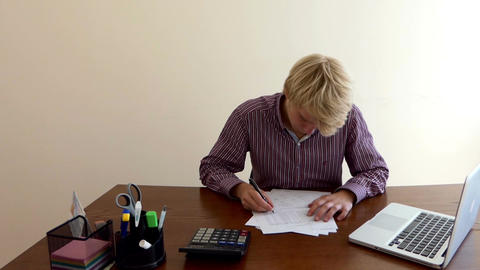 Young Blond Man Writes a Doc, Looks Up, Throws All Papers Away, in Slo-Mo Live-Action