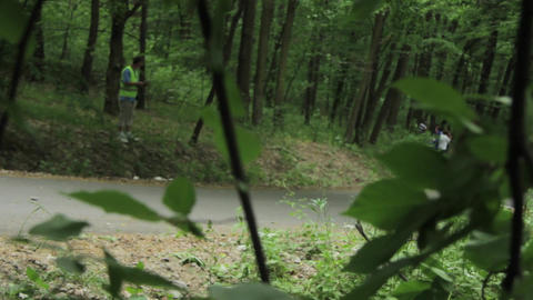 Red rally car seen among the green leaves - 04 Footage