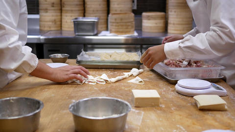 Motion of people are kneading the dough and shaping it with their hands to make Footage