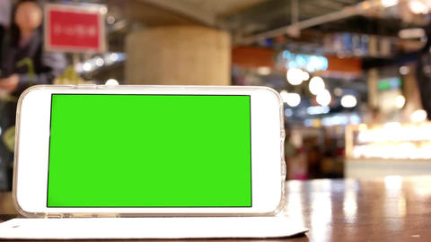Motion of green screen phone with blur people shopping and resting inside mall Footage
