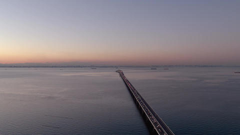 Aerial - Video by rising Tokyo Bay and Bridge in the evening Footage