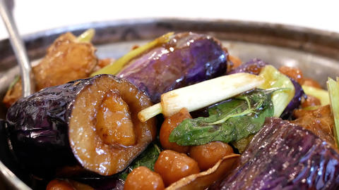 Motion of stewed chinese yam and eggplant on table inside Chinese restaurant Footage