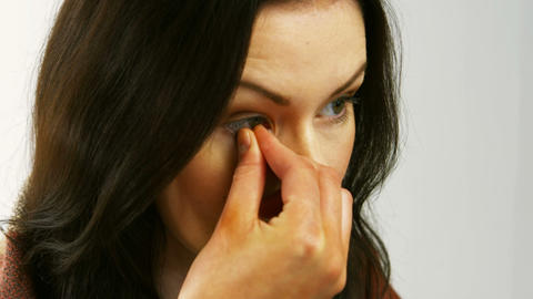 Woman removing her contact lenses Footage