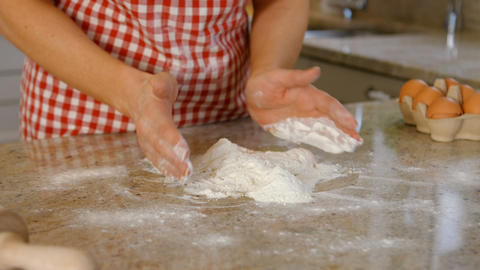Woman baking with egg and flour Footage