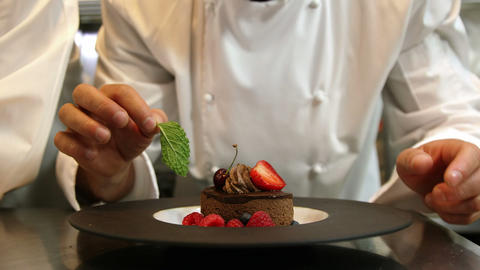 Chefs putting finishing touch on desserts Footage