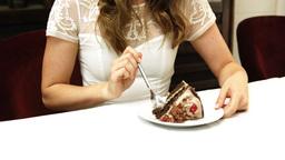 Pretty girl eating chocolate cake Footage