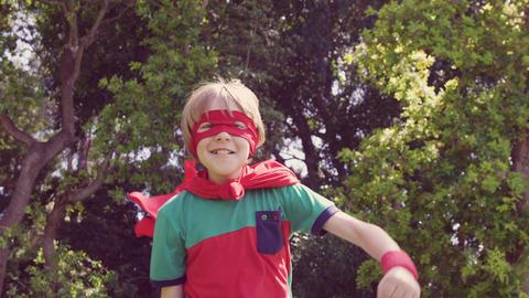 Boy pretending to be superhero Footage