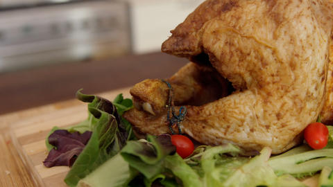 Roast chicken and salad on table Live Action