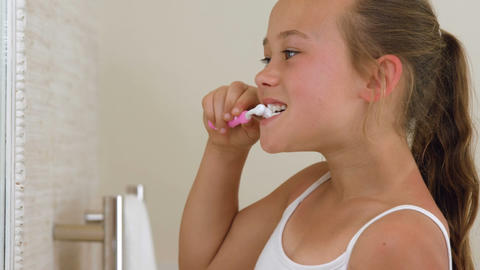 Little girl brushing her teeth Footage