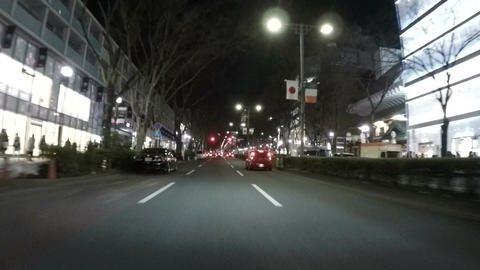 Nightscape of busy Omotesando shopping district in slow motion Footage