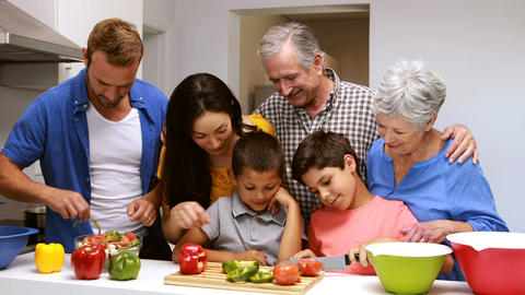 Happy family preparing vegetables Footage