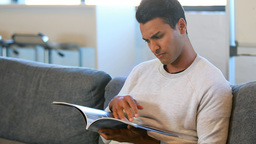 Man reading a magazine in a waiting room Live Action