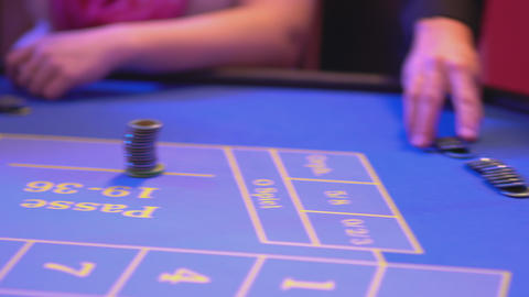 Roulette table in a casino - groupier pays out win for new game Live Action
