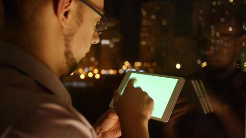 men scrolls browser on tablet Live Action